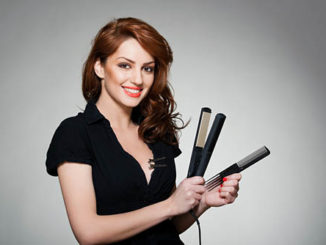beautiful woman with a flat iron and comb